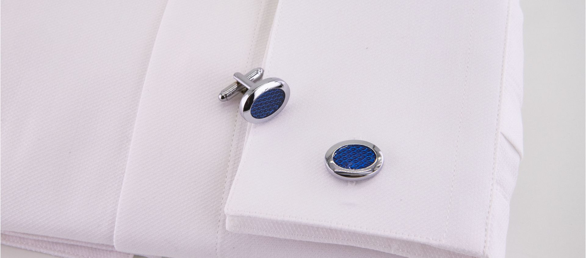 gemelli ovali blu e acciaio